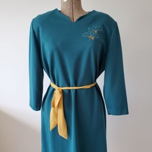 Vintage turquoise dress with embroidered acorn